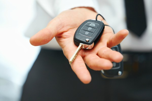 Owner of new vehicle with keys after receiving Car Finance in Perth